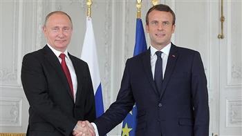 بوتين يبحث مع ماكرون وميركل التسوية الأوكرانية