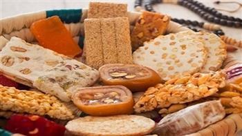 ما حكم شراء الحلوى والتهادي بها؟